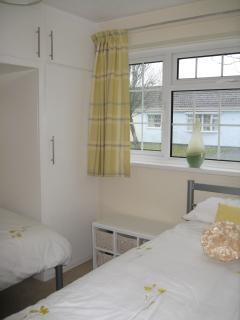 Twin room, 2 single beds. Travel cot stored under beds. Spare bedding in overbed cupboard.
