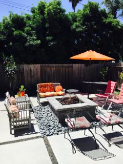 Wonderful backyard space to gather together (around the fire pit or under the gazebo)