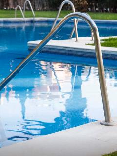 Swimming pool is gated with electronic keys for residents.