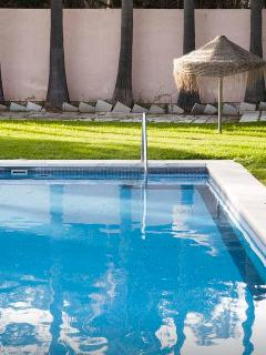 Swimming pool is gated with electronic access for residents.