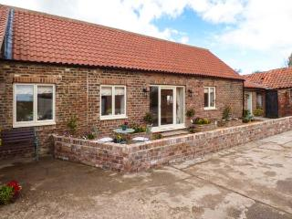 THE BYRE, red brick barn conversion, all ground floor, en-suite, parking, patio,