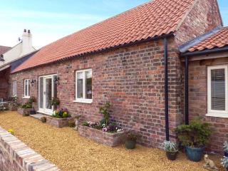 THE BYRE, red brick barn conversion, all ground floor, en-suite, parking, patio,