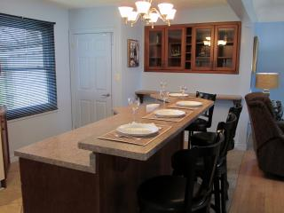 An open concept kitchen and dining area provides for a relaxing, airy atmosphere.
