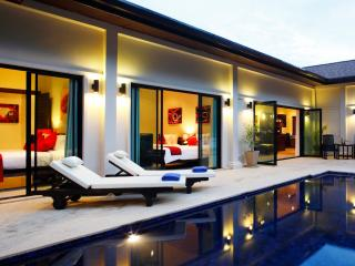 Built around a large 8 x 4 metre swimming pool with integral Jacuzzi and swim up bar stools