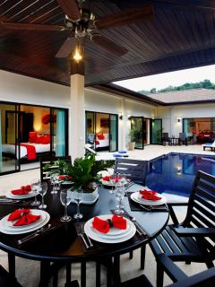 The sala, with large gas BBQ, adjacent to the swimming pool, with feature swim up bar stools