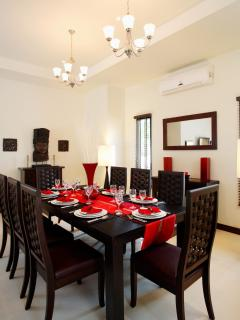 Inside dining, teak dining table and 10 chairs is ideal for a formal dining