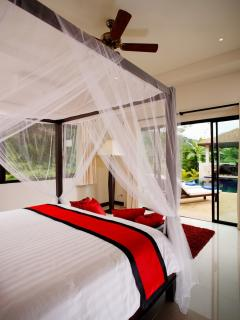 Master Bedroom with large sliding doors to access the private swimming pool and sun deck