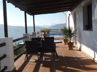 Casita La Loma private terrace with swimming pool beyond