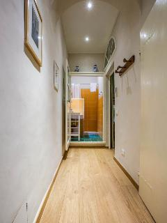 hallway leading from kitchen to bathrooms and bedroom