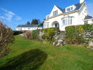 BRYN HOEL, detached, double bay fronted cottage, sea views, roll-top bath, off