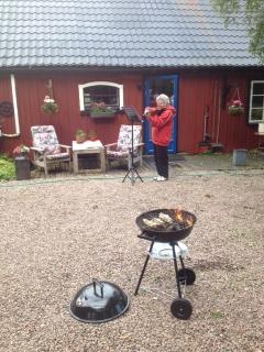 One of our guest playing  violin waiting for the BBQ