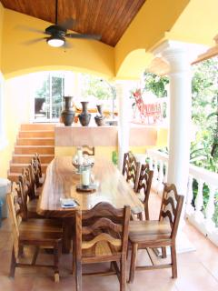 Guanacaste wood table with seating for 10