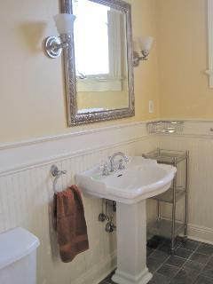 Pedestal sink in bathroom upstairs