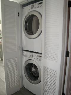 Full sized washer and dryer in hall closet