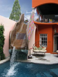 The private pool, with its waterslide from the outdoor living area.