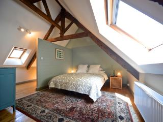 Bedroom with kingsize bed and en-suite bathroom