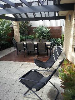 alfresco area with 8 seater outdoor dining table and barbecue