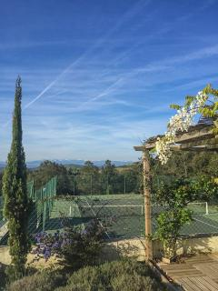 The stunning tennis court with its beautiful views.