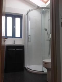 Beautifully appointed bathroom, light & airy for showering under blue skies or night stars.