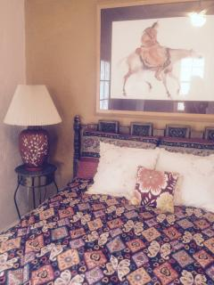 Full size bed.  Headboard from the property.