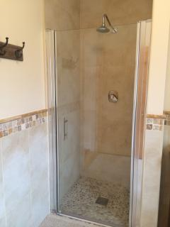 Walk-In Shower in en-suite bathroom-- with pebble floor