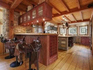 Expansive country kitchen with saddle bar stools