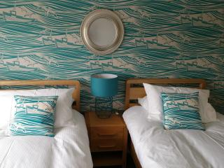 Bedroom 2 has stunning views over the harbour in Whitby. Sleeps 2 in twin beds. Space for travel cot