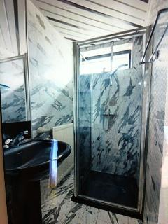Bathroom with toilet, waterbassin and shower