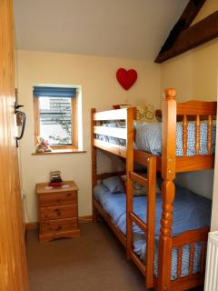 Bedroom number 3 is the 'childrens' bunk bed room