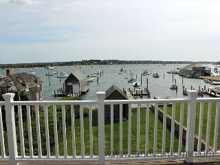 READ THE MORNING PAPER ON THE DECK NEAR WATER'S EDGE IN THIS CAPTAIN'S HOUSE