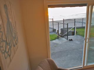 Sliding glass doors open onto a grass patio