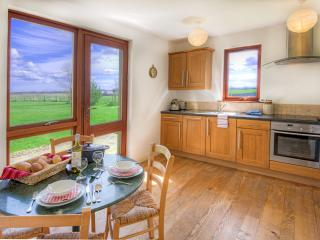 Kitchen at Garden Cottage with French doors leading to the garden and views across the countryside