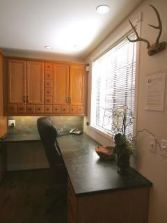 Desk area next to kitchen
