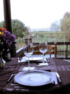 Panoramic river and countryside views while you dine in the conservatory