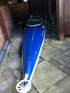 1 seater 14 foot 7 inches long canoe with rear stearing aid