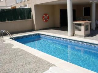 Apartamento a 350 m de la playa con piscina y aire acondicionado
