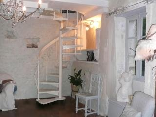 Spiral staircase from sitting room to bedroom