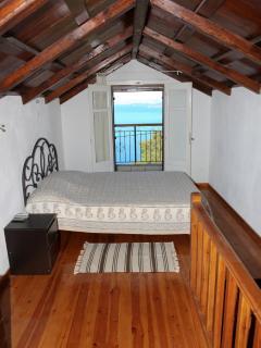 Spacious master bedroom with double door to breakfast balcony