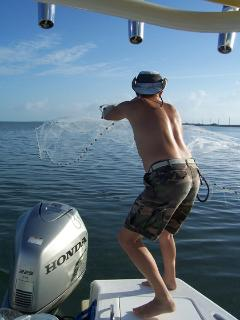 Cast netting your bait is a tried and true Florida Keys fishing experience on any trip.
