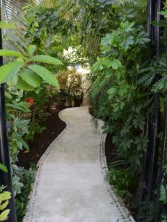 . Stress melts away as you step through the gate into the tropical-plant-enclosed entrance.