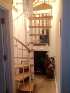 Spiral staircase to attic room.