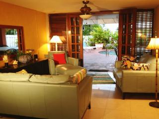 Comfortable seating for up to 12 adults..living area opens onto pool lanai.