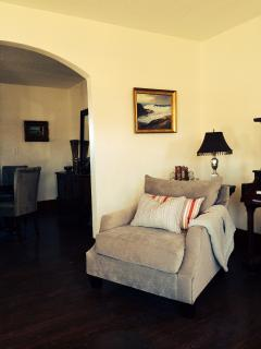 comfy livingroom with lovely original art and collectables