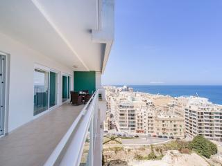 Huge terrace overlooking the Sliema promenade with open ocean views.