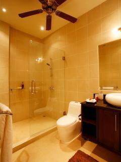 Bedroom 4 bathroom with walk in shower and vanity unit