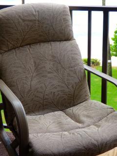 Tropitone swivel rocker chairs on the lanai