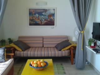 sofa bed in private alcove; personal window, curtains can be closed, artist original painting