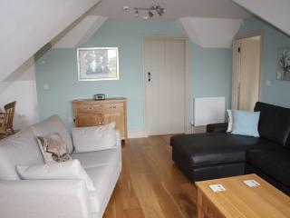 There's a large living room with lots of space to relax in comfort and seating for up to 8 people
