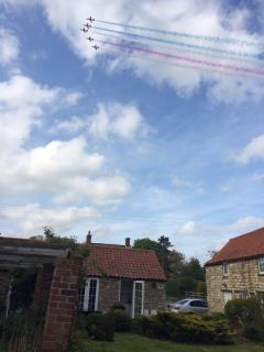 Red arrows overhead