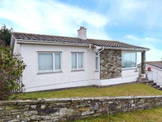 GODOLPHIN, detached bungalow with sea views, open fire, enclosed garden, ideal